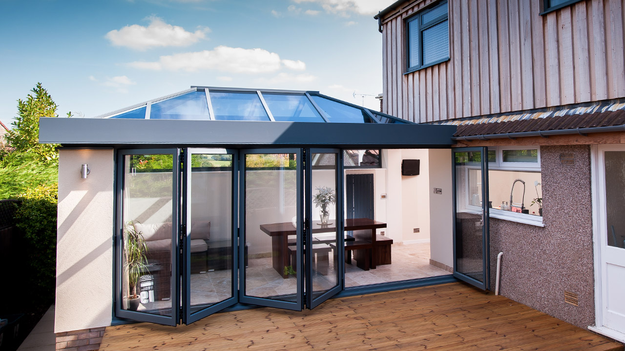 House with a patio and bi-folding doors