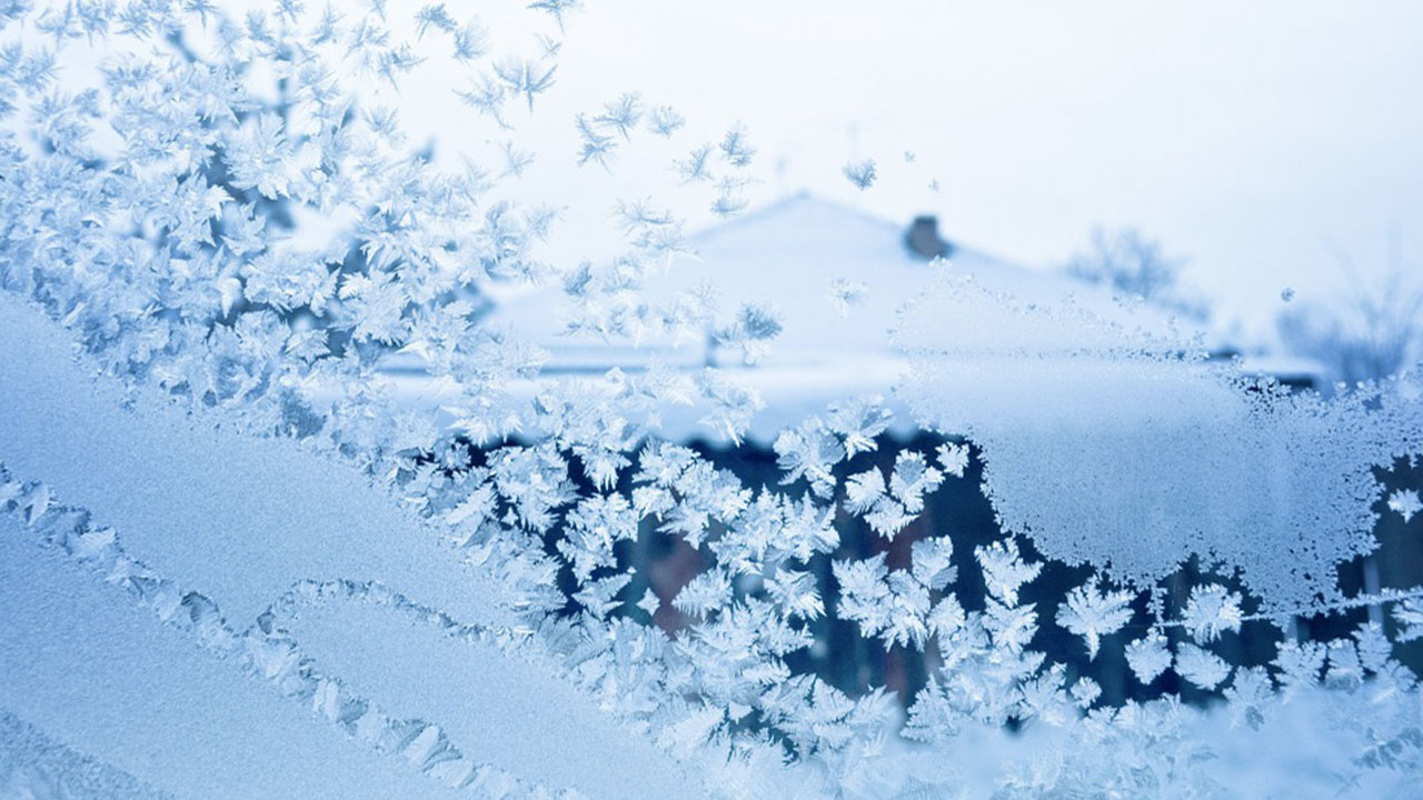 Frozen window with ice and snow